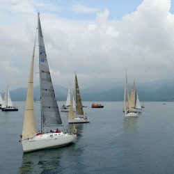 A group of boats sail below a Longstaff Media Aerial Drone