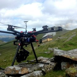 A Longstaff Media Drone punched on a hillside as a steam train passes by in the background.