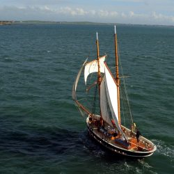 A sailing boat is captured on the sea in this aerial shot by a Longstaff Media drone.